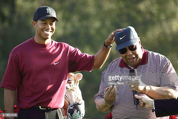 Tiger Woods plays around with his father, Earl Woods, during the trophy presentation of the Target World Challenge on December 12, 2004 at Sherwood...