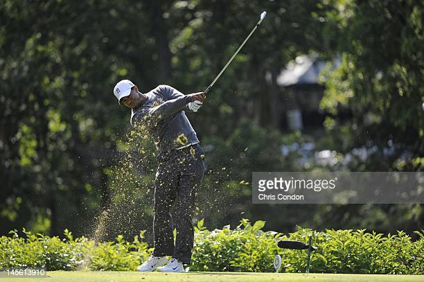 Tiger Woods plays from the 18th tee during the third round of the Memorial Tournament presented by Nationwide Insurance at Muirfield Village Golf...