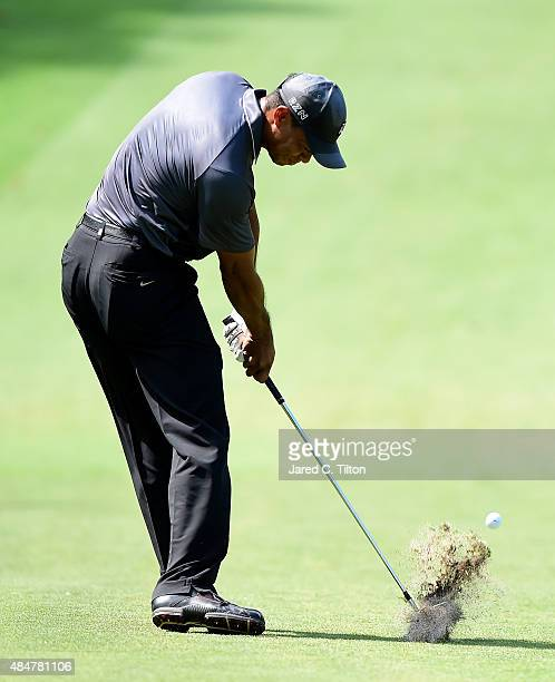 Tiger Woods plays from the fairway on the ninth hole during the second round of the Wyndham Championship at Sedgefield Country Club on August 21,...