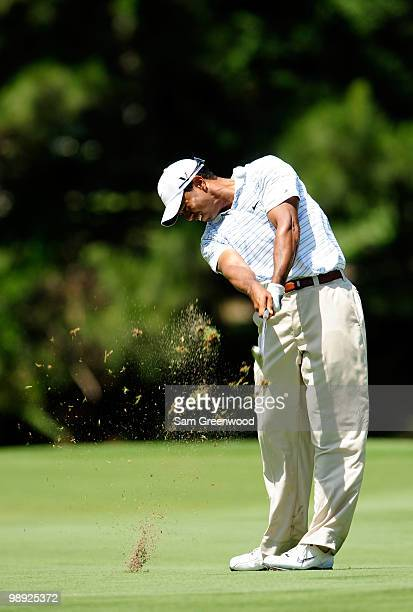 Tiger Woods plays his approach shot on the fairway of the seventh hole during the third round of THE PLAYERS Championship held at THE PLAYERS Stadium...