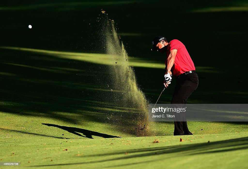 Tiger Woods plays his second shot from the fairway on the 17th hole during the final round of the Wyndham Championship at Sedgefield Country Club on August 23, 2015 in Greensboro, North Carolina.