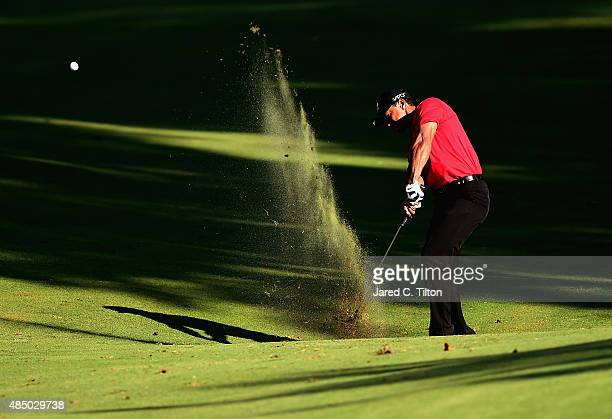 Tiger Woods plays his second shot from the fairway on the 17th hole during the final round of the Wyndham Championship at Sedgefield Country Club on...