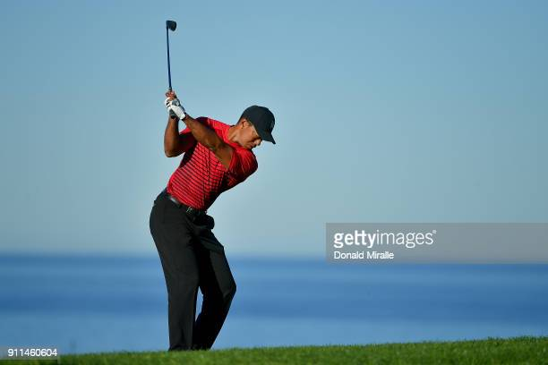 Tiger Woods plays his second shot on the 12th hole during the final round of the Farmers Insurance Open at Torrey Pines South on January 28 2018 in...