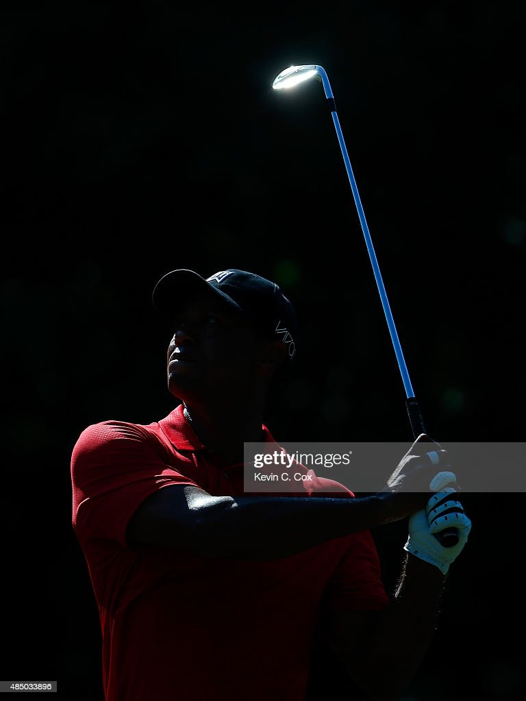 Tiger Woods plays his second shot on the 13th hole during the final round of the Wyndham Championship at Sedgefield Country Club on August 23, 2015 in Greensboro, North Carolina.