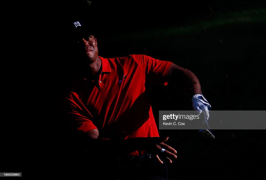 Tiger Woods plays his second shot on the 17th hole during the final round of the Wyndham Championship at Sedgefield Country Club on August 23, 2015 in Greensboro, North Carolina.