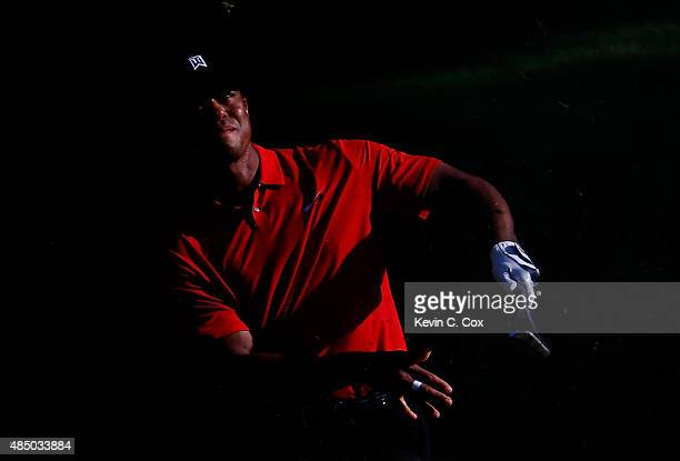 Tiger Woods plays his second shot on the 17th hole during the final round of the Wyndham Championship at Sedgefield Country Club on August 23 2015 in...