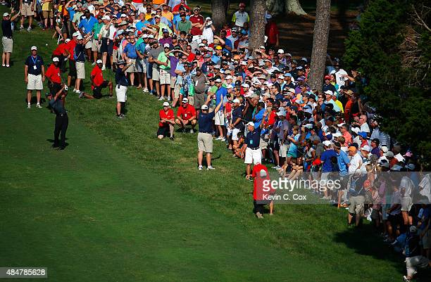 Tiger Woods plays his second shot on the 18th hole during the second round of the Wyndham Championship at Sedgefield Country Club on August 21, 2015...