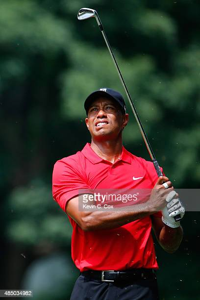 Tiger Woods plays his second shot on the fourth hole during the final round of the Wyndham Championship at Sedgefield Country Club on August 23 2015...