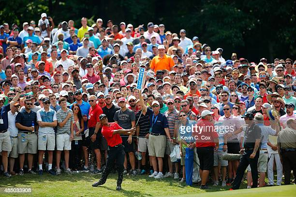 Tiger Woods plays his second shot on the seventh hole during the final round of the Wyndham Championship at Sedgefield Country Club on August 23 2015...