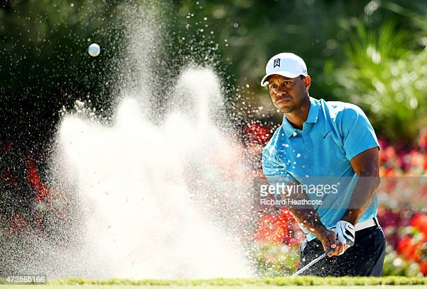 Tiger Woods plays his shot from a bunker to the 14th green during round two of THE PLAYERS Championship at the TPC Sawgrass Stadium course on May 8,...
