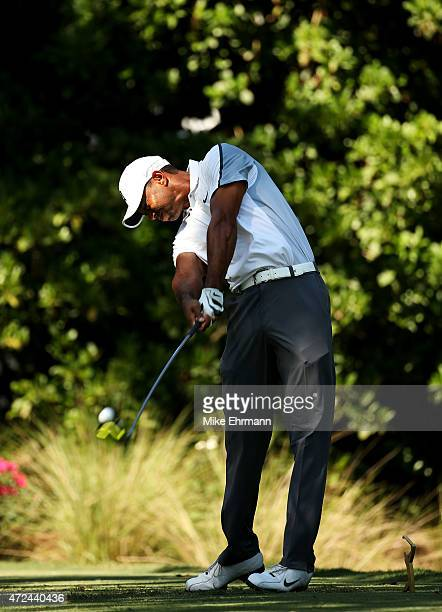 Tiger Woods plays his shot from the 11th tee during round one of THE PLAYERS Championship at the TPC Sawgrass Stadium course on May 7, 2015 in Ponte...