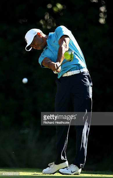 Tiger Woods plays his shot from the 11th tee during round two of THE PLAYERS Championship at the TPC Sawgrass Stadium course on May 8 2015 in Ponte...