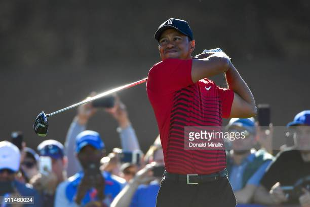 Tiger Woods plays his shot from the 14th tee during the final round of the Farmers Insurance Open at Torrey Pines South on January 28 2018 in San...