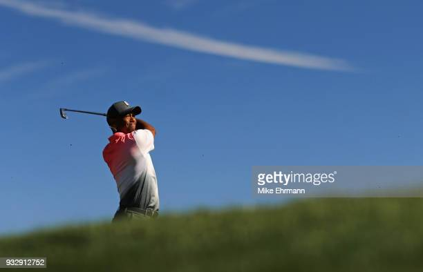 Tiger Woods plays his shot from the 14th tee during the second round at the Arnold Palmer Invitational Presented By MasterCard at Bay Hill Club and...