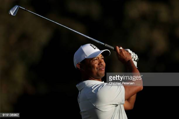 Tiger Woods plays his shot from the 16th tee during the second round of the Genesis Open at Riviera Country Club on February 16 2018 in Pacific...
