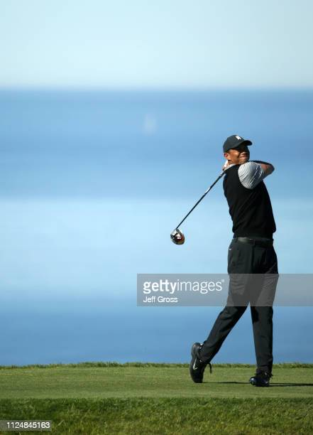 Tiger Woods plays his shot from the 17th tee on the North Course during the second round of the 2019 Farmers Insurance Open at Torrey Pines Golf...