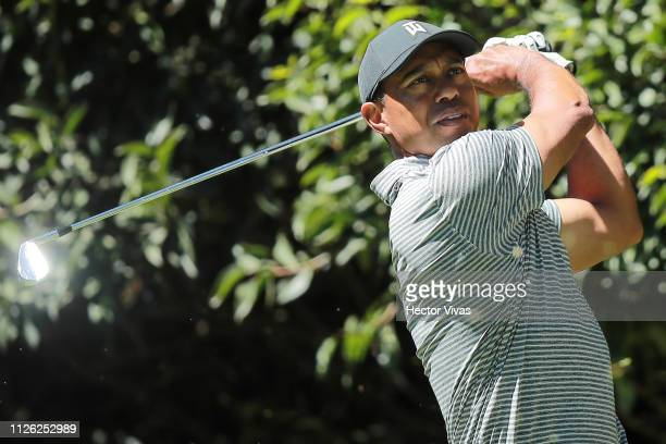 Tiger Woods plays his shot from the 2nd tee during the practice round of World Golf ChampionshipsMexico Championship at Club de Golf Chapultepec on...