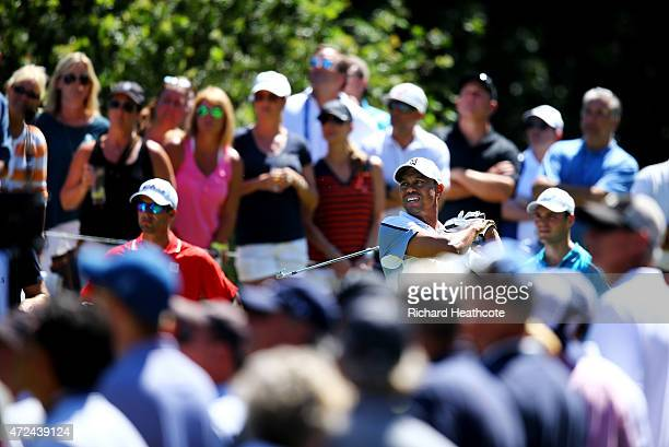 Tiger Woods plays his shot from the eighth tee during round one of THE PLAYERS Championship at the TPC Sawgrass Stadium course on May 7, 2015 in...