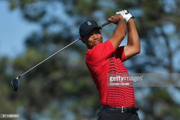 Tiger Woods plays his shot from the fifth tee during the final round of the Farmers Insurance Open at Torrey Pines South on January 28 2018 in San...