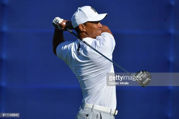 Tiger Woods plays his shot from the seventh tee during the third round of the Farmers Insurance Open at Torrey Pines South on January 27 2018 in San...