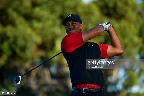 Tiger Woods plays his shot from the tenth tee during the final round of the Farmers Insurance Open at Torrey Pines South on January 28 2018 in San...