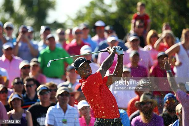 Tiger Woods plays his shot from the third tee during the final round of THE PLAYERS Championship at the TPC Sawgrass Stadium course on May 10 2015 in...