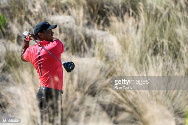 Tiger Woods plays his shot from the third tee during the final round of the Hero World Challenge at Albany course on December 3 2017 in Nassau Bahamas