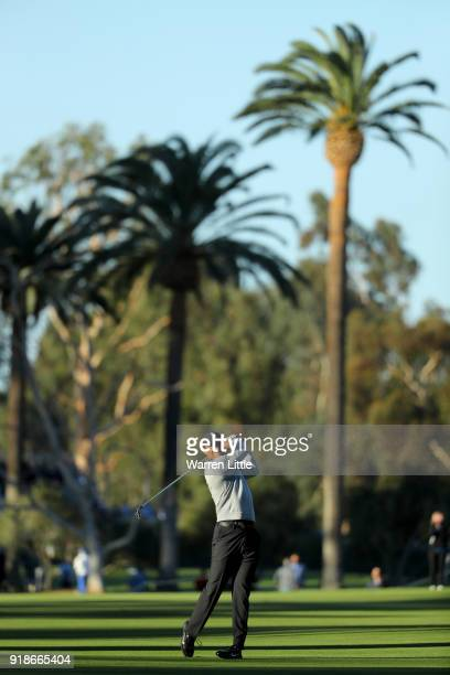 Tiger Woods plays his shot on the 11th hole during the first round of the Genesis Open at Riviera Country Club on February 15 2018 in Pacific...
