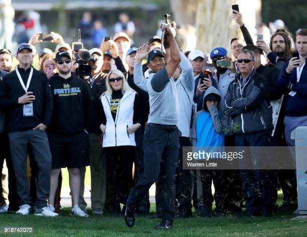 Tiger Woods plays his shot on the 12th hole during the first round of the Genesis Open at Riviera Country Club on February 15 2018 in Pacific...
