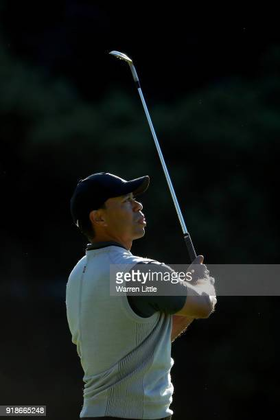 Tiger Woods plays his shot on the 13th hole during the first round of the Genesis Open at Riviera Country Club on February 15 2018 in Pacific...