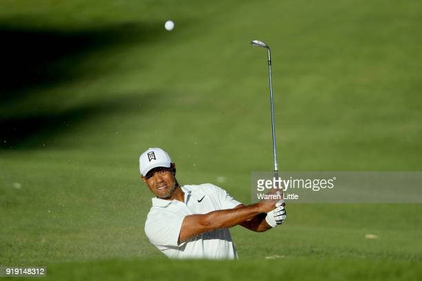Tiger Woods plays his shot on the 14th hole during the second round of the Genesis Open at Riviera Country Club on February 16 2018 in Pacific...