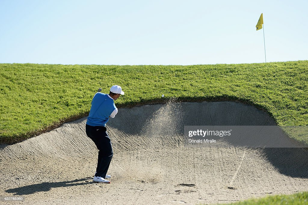 Tiger Woods plays his shot out of the bunker on the second hole during the first round of the Farmers Insurance Open at Torrey Pines South on January 26, 2017 in San Diego, California.