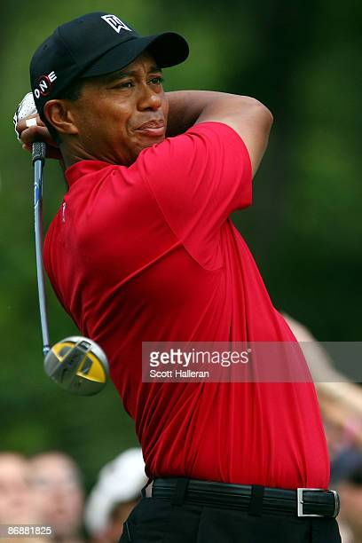 Tiger Woods plays his tee shot on the second hole during the final round of THE PLAYERS Championship on THE PLAYERS Stadium Course at TPC Sawgrass on...