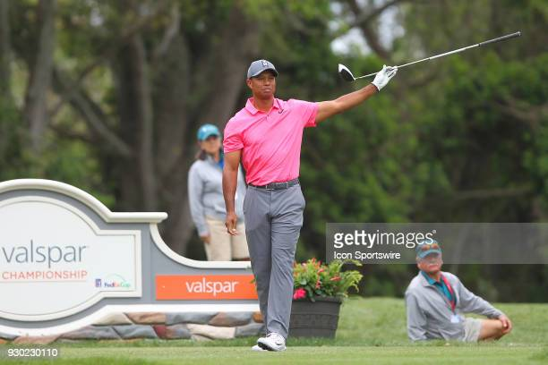 Tiger Woods points his club to his left to warn the fans along the 11th fairway during the third round of the Valspar Championship on March 10 at...