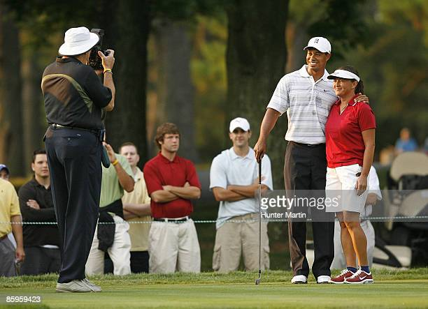 JULY 4 Tiger Woods poses for a photograph with playing partner Sergeant Major Mia Kelly during the ATT National Earl Woods Memorial ProAm at...
