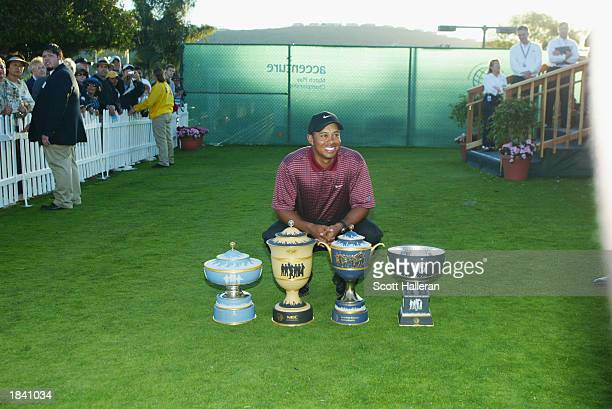 Tiger Woods poses with all four World Golf Championship trophies which he has now won with his victory at the Accenture Match Play Championship on...