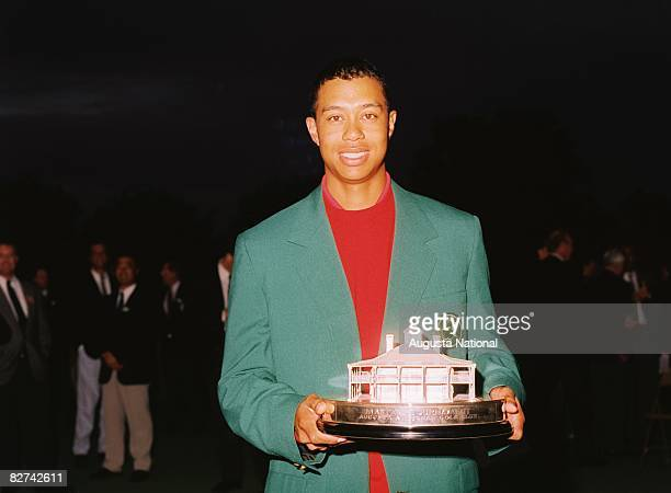 Tiger Woods poses with his trophy after the 1997 Masters Tournament at Augusta National Golf Club on April 13 1997 in Augusta Georgia