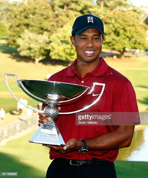 Tiger Woods poses with the 2009 FedExCup after the final round of THE TOUR Championship presented by CocaCola the final event of the PGA TOUR...