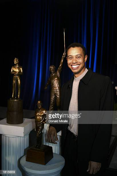 Tiger Woods poses with the Arnold Palmer Jack Nicklaus and Byron Nelson Award Trophies all of which he won during the PGA Awards Ceremony for 2002 at...