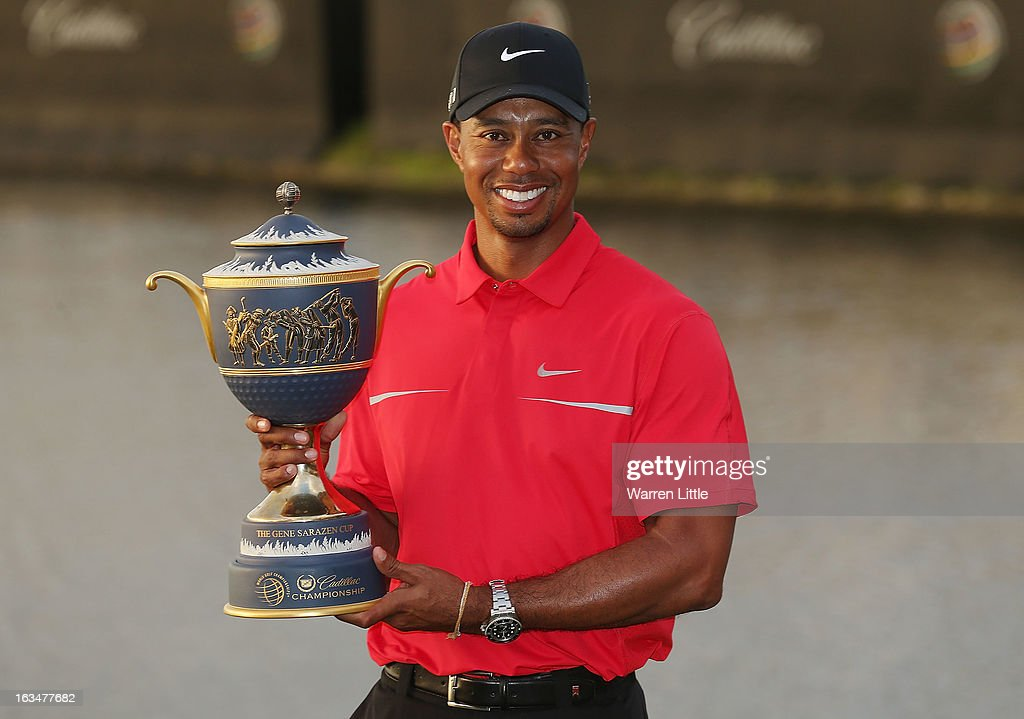 Tiger Woods poses with the Gene Sarazen Cup after his two-stroke victory at the World Golf Championships-Cadillac Championship at the Trump Doral Golf Resort & Spa on March 10, 2013 in Doral, Florida.