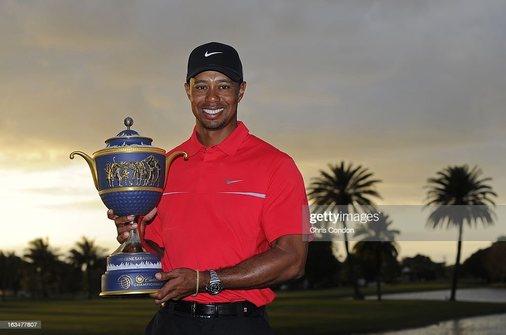 Tiger Woods poses with the Gene Sarazen Cup after winning the World Golf Championships-Cadillac Championship at TPC Blue Monster at Doral on March 10, 2013 in Doral, Florida.