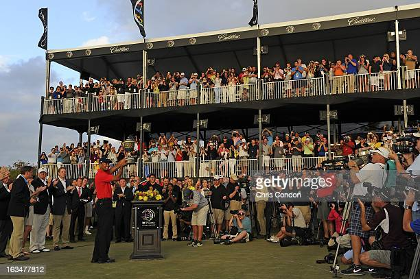 Tiger Woods poses with the Gene Sarazen Cup after winning the World Golf ChampionshipsCadillac Championship at TPC Blue Monster at Doral on March 10...