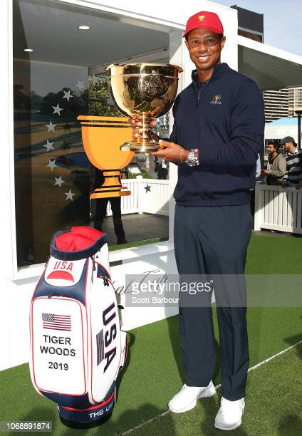 Tiger Woods poses with the Presidents Cup during a Presidents Cup media opportunity at the Yarra Promenade on December 5 2018 in Melbourne Australia...