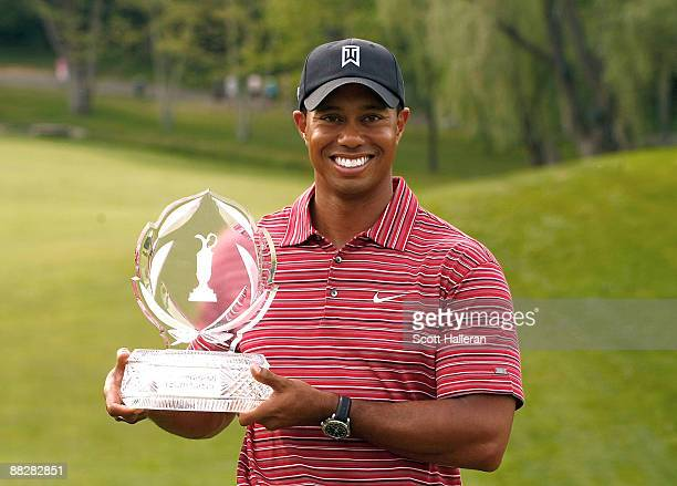 Tiger Woods poses with the trophy after a one-stroke victory at the Memorial Tournament at the Muirfield Village Golf Club on June 7, 2009 in Dublin,...