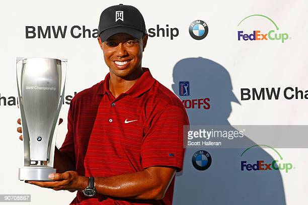 Tiger Woods poses with the trophy after his eightstroke victory at the BMW Championship held at Cog Hill Golf CC on September 13 2009 in Lemont...