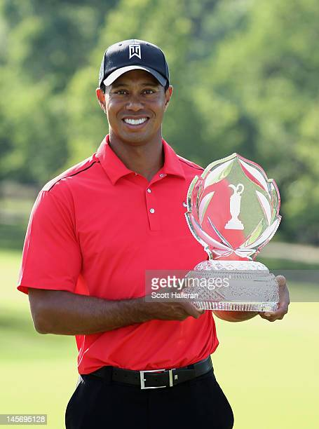 Tiger Woods poses with the trophy after his two-stroke victory at the Memorial Tournament presented by Nationwide Insurance at Muirfield Village Golf...