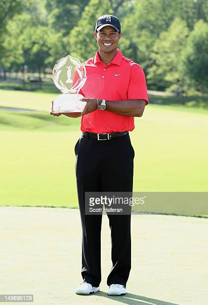 Tiger Woods poses with the trophy after his twostroke victory at the Memorial Tournament presented by Nationwide Insurance at Muirfield Village Golf...