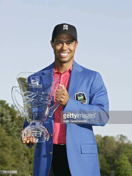 Tiger Woods poses with the trophy after winning the 2007 Wachovia Championship held at Quail Hollow Country Club in Charlotte North Carolina on May 6...