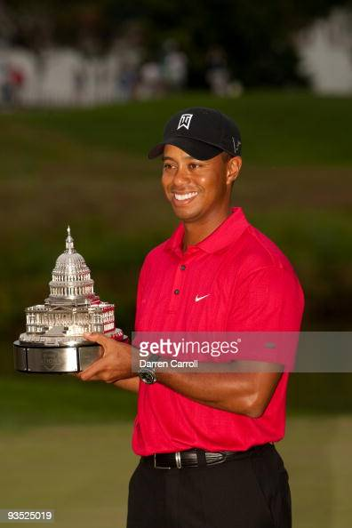 Tiger Woods poses with the trophy after winning the 2009 ...