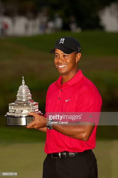 Tiger Woods poses with the trophy after winning the 2009 AT&T National hosted by Tiger Woods, held at Congressional Country Club on July 5, 2009 in...